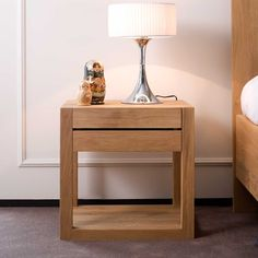 Natural Polished Wooden Bed Side Table With Drawer And Square Legs Placed On…
