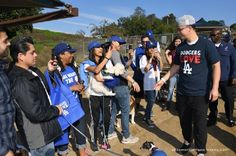After a brief rain delay Joc Pederson finally had the opportunity to meet with throngs of Dodger fans with their dogs at the Silverlake Dog Park yesterday.  It was a part of the week-long Dodgers Love L.A. Community Tour that concludes today.