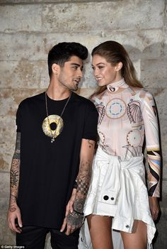 Look of love: Gigi looked at her beau with total adoration as she stepped off the catwalk for one night only