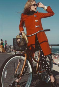 red coat, star leggings, bicycle, whimsical facial expression. #notmyreality #pinterestpretender
