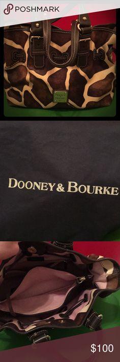 Dooney & Bourke Handbag Giraffe print medium sized handbag. Used but good condition. Dooney & Bourke Bags