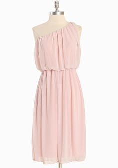 "Joffrey Pink One Shouldered Dress 32.99 at shopruche.com. Soft and ethereal, this light pink dress has a draped chiffon overlay, a subtly ruffled hem, and an elasticized waistline. Add statement jewelry to complete the look.  100% Polyester, Made in USA, 41"" from top of shoulder"