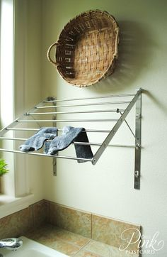 This just makes sense. Install a fold out drying rack on the wall of your laundry room at any height.