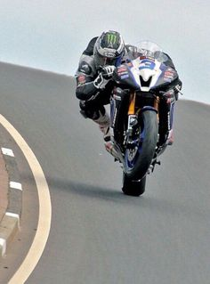 Michael Dunlop steering with the back wheel off the side of the bike