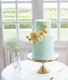 mint wedding cake with yellow flowers