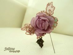 Pin with flower and grape