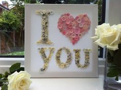 Hand made button art, I LOVE YOU On durable white canvas.