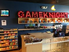 A new game store has come to the Chicago Suburbs. The Game Knight game store has all the makings for a great FLGS. Board Game Store, Board Game Cafe, Board Games, Boys Room Design, Game Room Design, Lounge Design, Game Organization, Game Storage, Diy Finish Basement