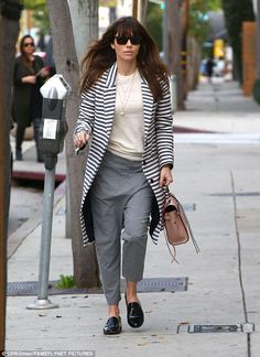 She's no slouch:She opted for slouchy, grey slacks and patent leather slip-on loafers, ac...