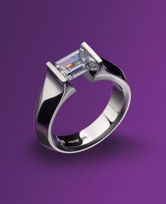LOVE his unique modern designs - Unisex Gothic Ring in Platinum featuring Emerald-cut center stone