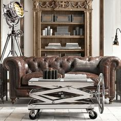 Homes with industrial style. LEATHER TUFTED SOFA LOVE!!!