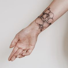 Peonies tattoo on the hand