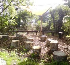 log seats under shade cloth, mulberry tree and lemon tree. Moveable, cheap and naturally beautful.