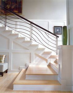 Shingle style home with an interesting staircase configuration...