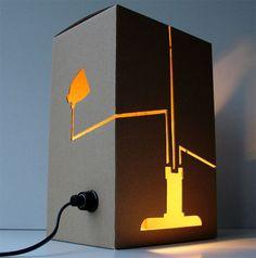 Not a Lamp by David Graas. Not a Lamp incorpora la silueta de una lámpara en la pantalla. Lo que brilla es esta silueta y no el espacio alrededor, ofreciendo un aspecto original.
