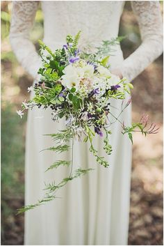 bouquet with purple blooms, photo by Ronel Kruger Photography http://ruffledblog.com/south-african-wine-estate-inspiration #weddingbouquet #flowers