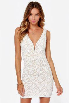 Put the Fashion Lace Off Ivory Lace Dress up against your closet full of dresses and you'll find ...