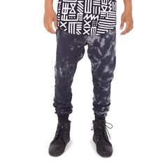 Men's full-length sweatpant jogger featuring indigo Smoke Dye wash on French terry cotton. Tapered with ribbed ankles at the bottom. Also available in X-Amount print. Designed by AndreasOne for PEACEfits.