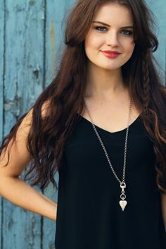Danon heart long chain necklace with black camisole and long brunette hair | Joli House