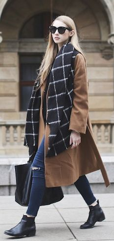 Just The Design: Pavlína Jágrová is wearing a brown coat from Inavati, window pane scarf from Zara and the boots are from Eye