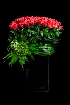Rose Harvest: Here's a design guaranteed to heat up the cool nights of autumn. 50 hot red roses are embraced by bold greens, rising out of a tall, modern black-glass vase. Beautiful flowers are always in fashion! Large Flower Arrangements, Vase Arrangements, Floral Centerpieces, Ikebana, Deco Floral, Arte Floral, Blossom Flower, Flower Art, Corporate Flowers