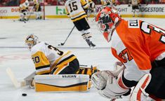 PHILADELPHIA, PA - APRIL 15: Brian Elliott #37 of the Philadelphia Flyers and Matthew Murray #30 of the Pittsburgh Penguins warm up prior to playing in Game Three of the Eastern Conference First Round during the 2018 NHL Stanley Cup Playoffs at the Wells Fargo Center on April 15, 2018 in Philadelphia, Pennsylvania. (Photo by Len Redkoles/NHLI via Getty Images)
