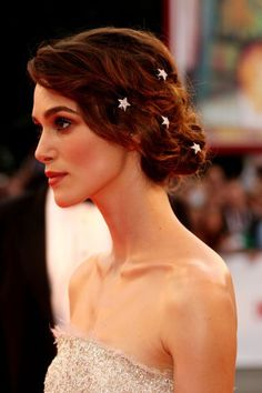 Is there anything more magical than a pretty chignon and tiny hair pins placed just so?