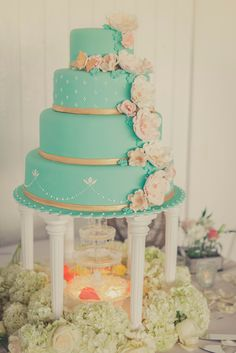 Blue Cake with Gold and Flowers. I like this minus the tall pillars.