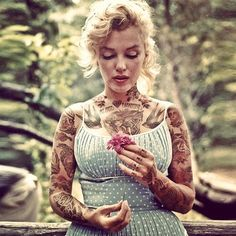 Have you ever wondered what your favorite celebrities would look like if they were heavily tattooed?   Yes, apparently it is possible to make Marilyn Monroe more beautiful.