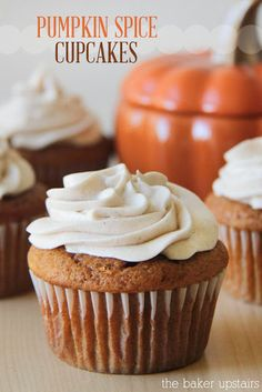Pumpkin spice cupcakes from The Baker Upstairs. A rich, moist pumpkin cupcake topped with a heavenly whipped cinnamon cream cheese frosting. A beautiful and delicious way to celebrate fall! www.thebakerupstairs.com