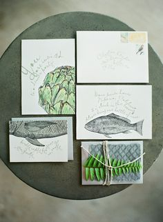 Cute invites!  #paper-goods, #fish, #invitations, #artichoke  Photography: Clayton Austin - loveisabird.com  Read More: http://www.stylemepretty.com/living/2013/10/04/an-intimate-farm-to-table-dinner-party/