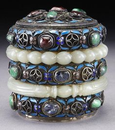"""Chinese enamel over silver and jade tea caddy, inlaid with a pair of jade bracelets. 3.25""""H x 3.25"""" Dia., Circa - 19th C."""