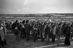 The drum leads the people to the mass grave of those who were killed in the 1890 massacre at Wounded Knee, 1973.  Photo credit: Owen Luck