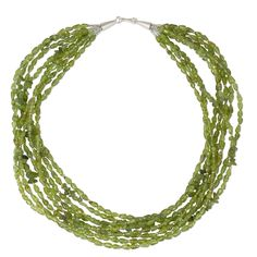 "NOVICA Peridot .925 Sterling Silver Beaded Necklace, 15"" 'Vibrant Clover'. An original NOVICA fair trade product in association with National Geographic. Includes an official NOVICA Story Card certifying quality & authenticity. NOVICA works with Sukanya Thongperm to craft this item. Includes an original NOVICA jewelry pouch to keep for yourself or give as a gift. A keepsake treasure designed to be loved for years to come."