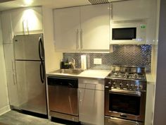 Small kitchen just for my space. I like everything: color, appliances, lights, tiles, display...