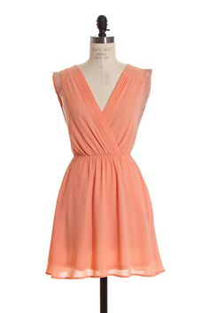 """One left in stock!! """"Cover Girl"""" peach/coral sparkle dress with pockets!! Shop Simply Me. FREE SHIPPING with every purchase!!"""