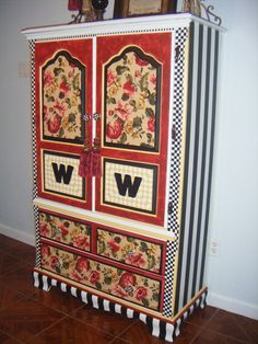 This was an old bedroom wardrobe, With Mackenzie-Childs inspiration I repainted it to match my LR, I modpodge'd (type of glue) the drawers and inlays on the doors with coordinating fabric...