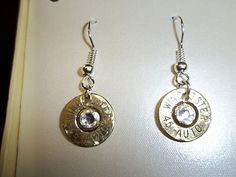 Bullet earrings. Made from real brass 45 cal. bullet casings with Swarovski crystals.