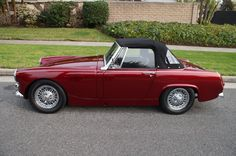 MG Midget. I want an MG Midget, white, with red roof and interior, and she shall be named Ethel. Thats the dream. - Sophie