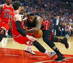 """www.sportsworldreport.com640 × 550Search by image Chicago Bulls guard Kirk Hinrich (12) fouls Miami Heat forward LeBron James (R) during the first half of their NBA basketball game in Chicago, Illinois March 27, 2013."""""""