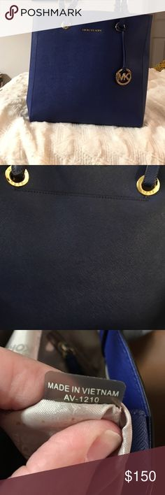 Michael Kors jet set Michael Kors royal blue jet set tote. Gently used. No marks or scuffs inside or out. Size 12L x 14H. Drop strap 9 inches. KORS Michael Kors Bags Totes