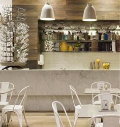 Marble bar, #industrial style with reclaimed wood wall- love the tables and chairs