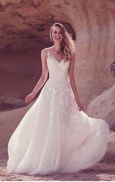 Soft tulles, intricate details and beautiful silhouettes combine to make these Ellis Bridals wedding gowns truly romantic and fabulously flattering... *Want more wedding dress advice? Here is our handy wedding dress shopping timeline and top tips for transporting your wedding dress*