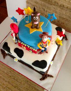 Cakesbykirsten Toy story cake.  Dark chocolate fudge cake with vanilla buttercream.  Hand sculpted sugar figures. #toy story cake #Pixar cakes # Woody, jessie, Bullseye