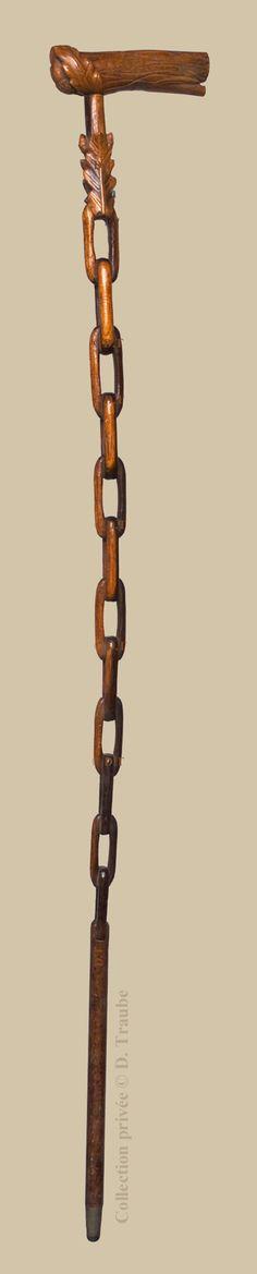 Canne Art Populaire monxyle entièrement ajourée - Décorée d'une chaine et de feuilles de chêne.
