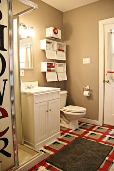 Boy bathroom make-over.  This bathroom is shared by four boys!  It looks awesome!