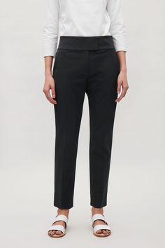 COS image 7 of Slim-fit pressfold trousers in Dark Navy
