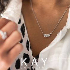 d5c3a3c47 This three-stone diamond necklace will make a sparkling style statement.  Sparkle, Jewelry. Kay