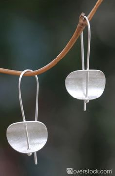 Give her a one of a kind gift this Valentine's. This handmade creation is offered in partnership with NOVICA, in association with National Geographic. The modern, minimalist design of these earrings is by Desi Antari in Bali. She crafts the sterling silver earrings by hand and finishes them with brushed satin textures.