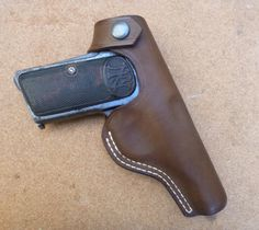 Double row seam belt holster for the Browning 1910 automatic pistol - custom made from makeitjones.co.uk